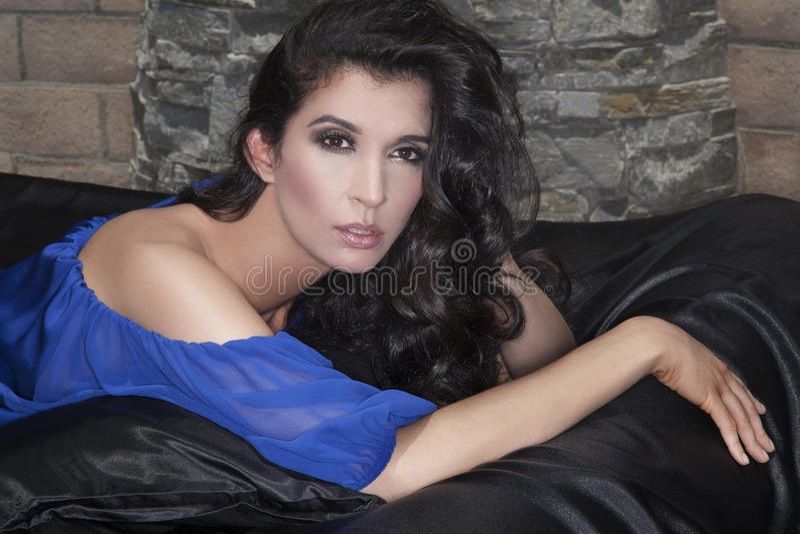 Glamorous woman lying on bed stock photos