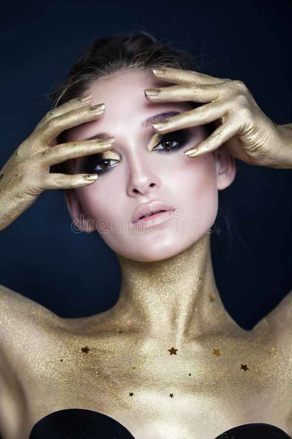 Glamorous Woman. Makeup and Golden Skin stock photo