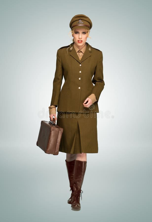 Glamorous woman in military uniform royalty free stock image