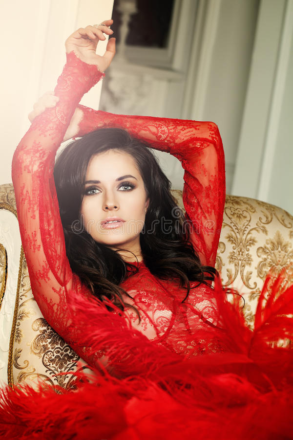 Glamorous Woman in Vintage Luxury Interior royalty free stock photography