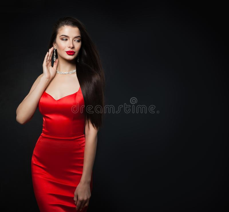 Glamorous woman wearing red dress. model with red lips stock photography
