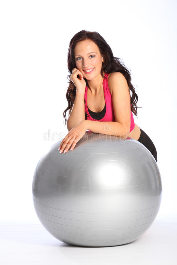 Glamorous young woman poses in gym fitness outfit stock photos