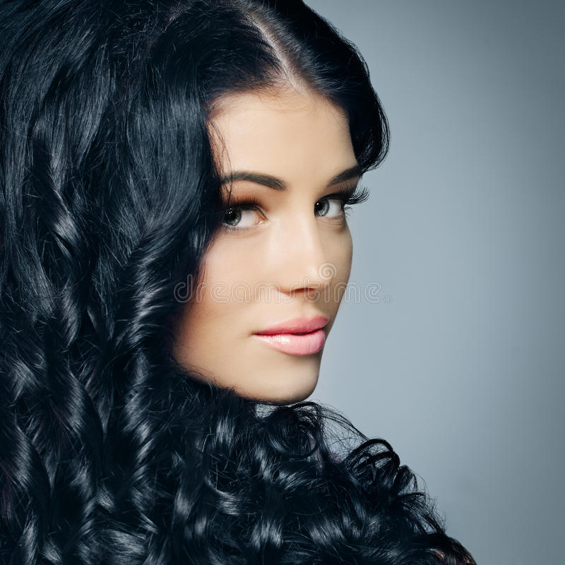 Glamour brunette with beautiful hair and makeup stock photography