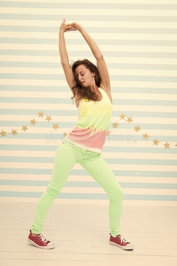 Glamour fashion model. Crazy girl in colorful sporty clothes. Happy and stylish sexy woman. Hip hop woman dancer royalty free stock image