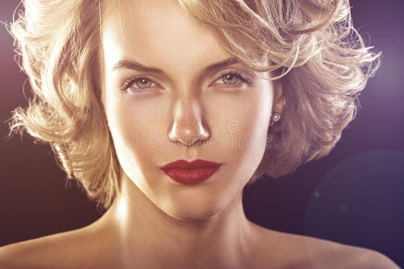 Glamour fashion shine portrait of beautiful curly woman royalty free stock image