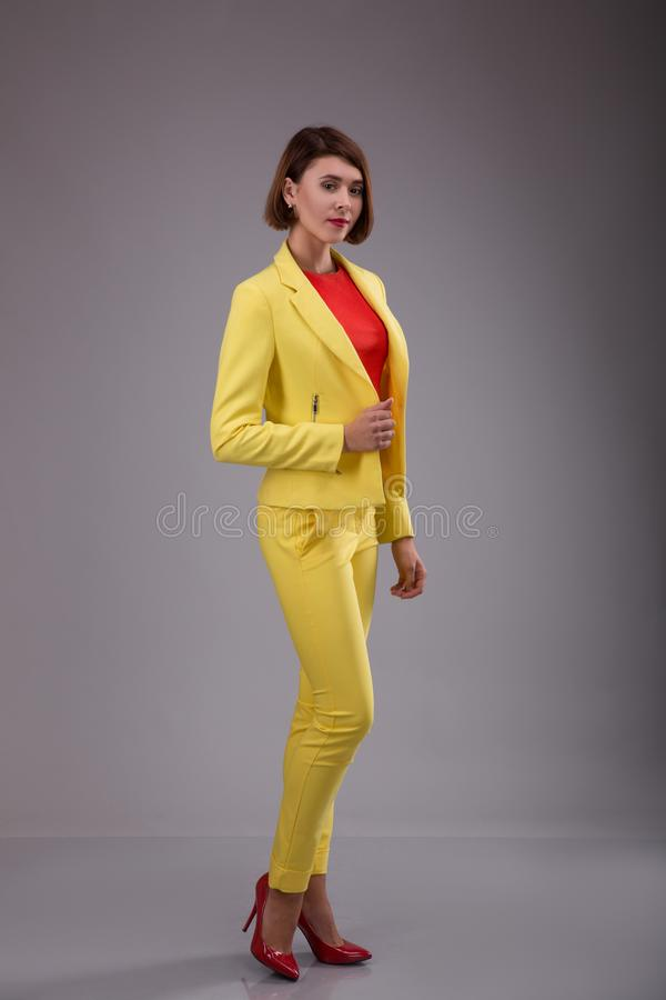 Glamour fashion style catalog casual clothes for business woman meeting date walk party beautiful woman brunette shot hair we stock photo