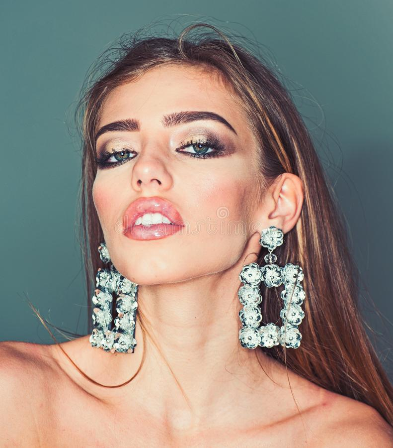 Glamour jewelry of luxury big earrings. Girl with lips makeup. Fashion model with trendy look. Beauty on party. My royalty free stock image