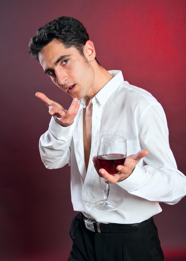 Glamour man with goblet of red wine. stock photos