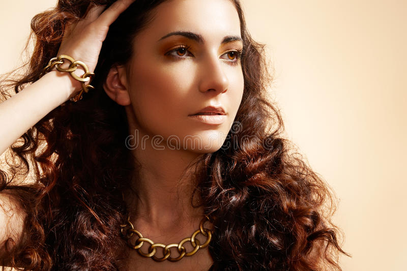Download Glamour Model With Shiny Gold Jewelry, Volume Hair Stock Image - Image: 16706491