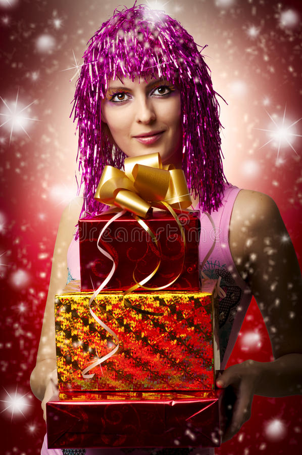 Glamour portrait of christmas happy woman, gifts. Glamour portrait of christmas happy woman model who holding three red, yellow boxes with gifts or christmas royalty free stock photo