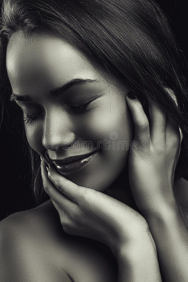 Glamour portrait smiling beautiful young woman in black white royalty free stock photos