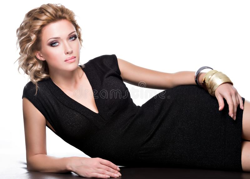 Glamour of a sensuality beautiful woman in black dress stock image