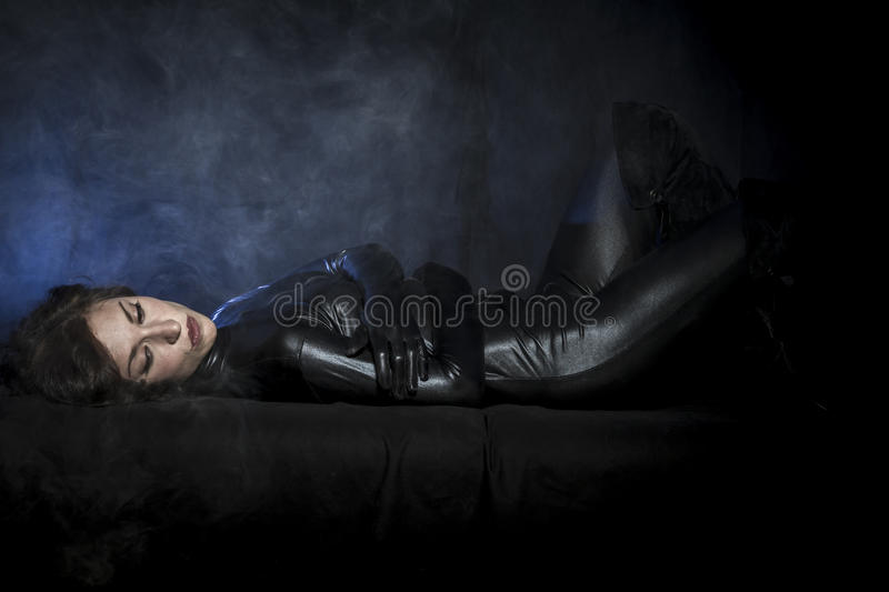 Glamour, brunette in black latex costume, Fashion shot of a royalty free stock image