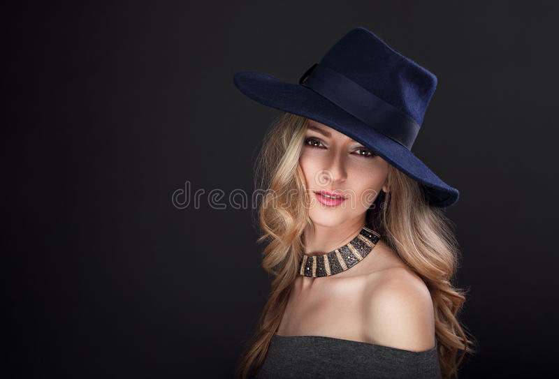 Glamour makeup blond long hair woman posing in fashion hat stock images