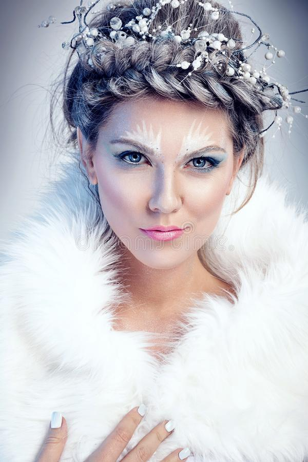 Snow queen in winter fur royalty free stock image