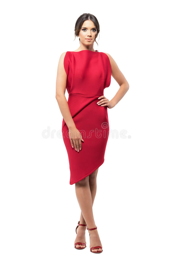 Glamour sophisticated elegant young woman in red evening dress posing at camera. stock photo