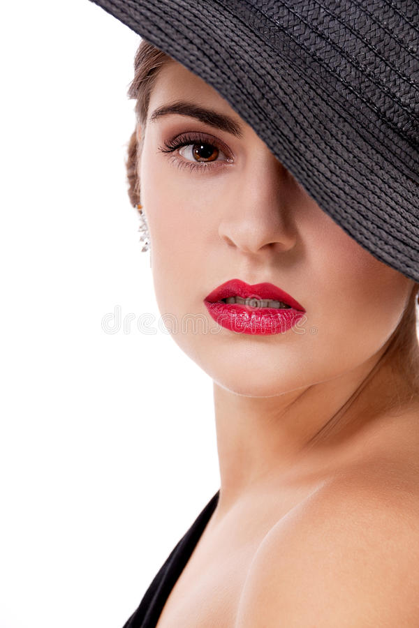 Glamour woman with black hat and red lips royalty free stock photos