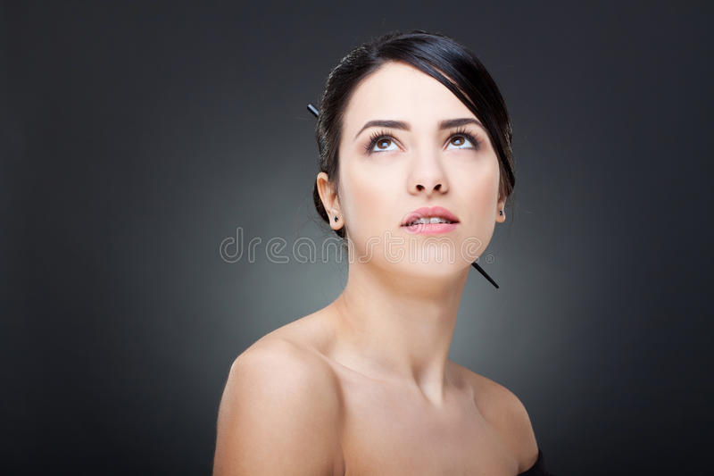 Glamour woman looking up stock photo