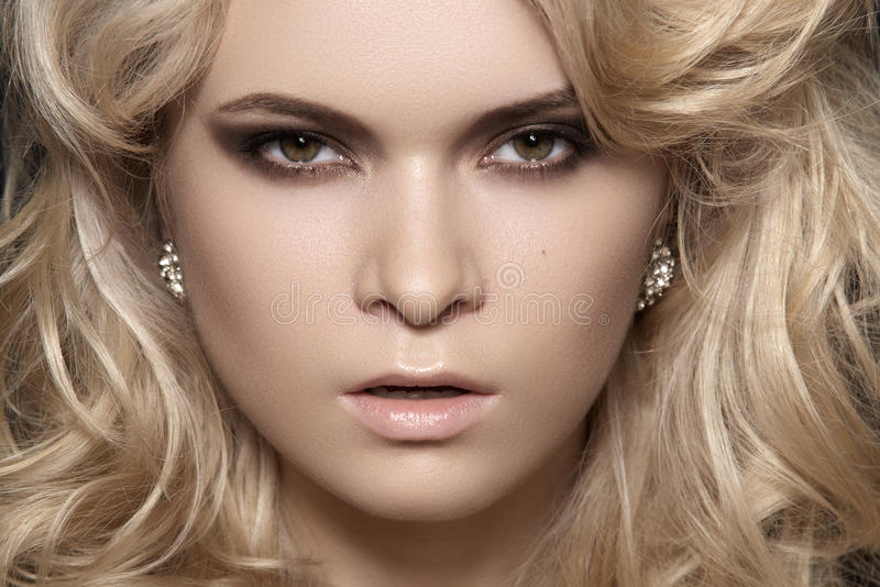 Glamour woman with make-up & chic shiny jewellery royalty free stock photo