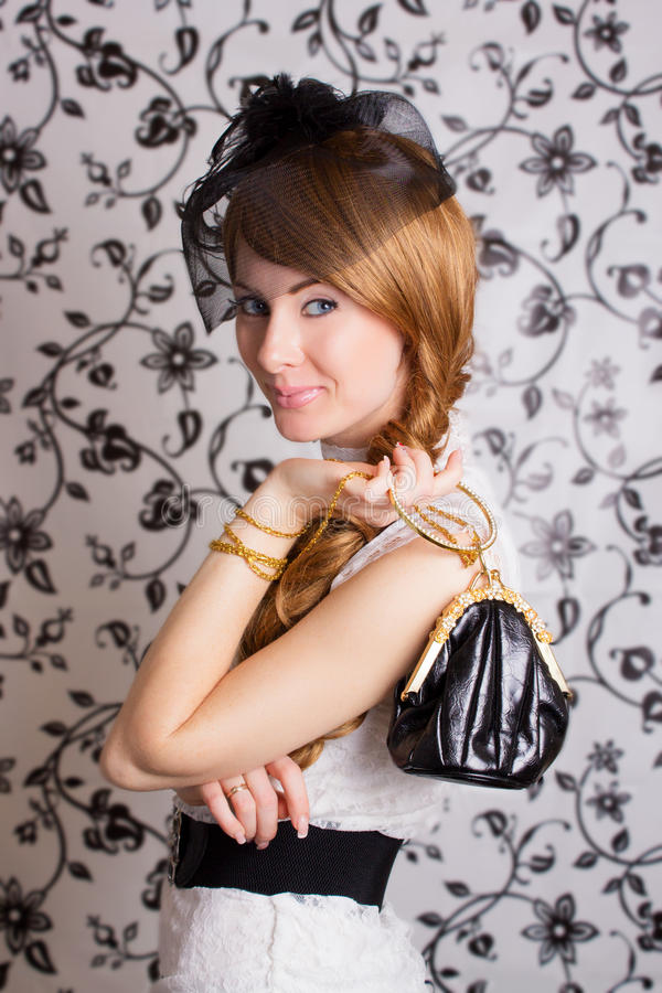 Glamouros retro-styled woman royalty free stock photography