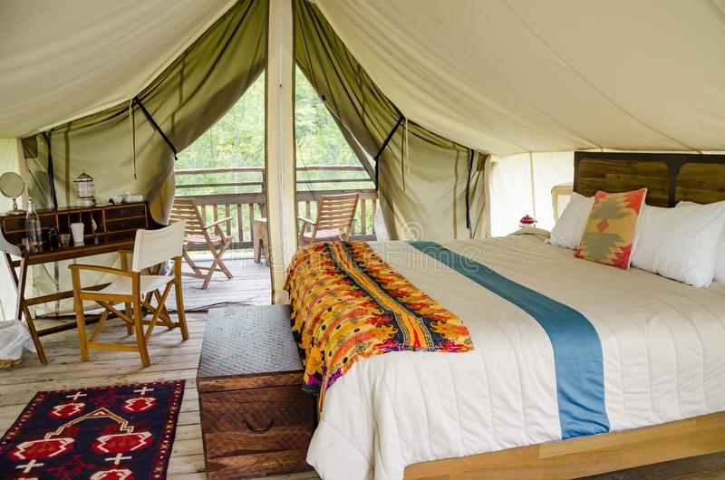 Glamping in New York. The inside of a glamor camping tent in New York State stock photos