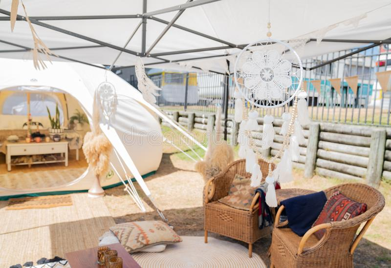Glamping tent and set up at Mount Maunganui. White fabric dreamcatcher hanging outside entrance to glamping tent and set up at Mount Maunganui stock photo
