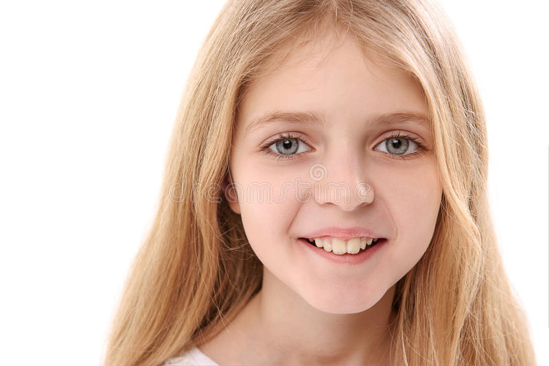 Glance of happy smiling child. Cheerful girl is looking at camera with happiness in her eyes. Isolated. Copy space. Portrait royalty free stock photo