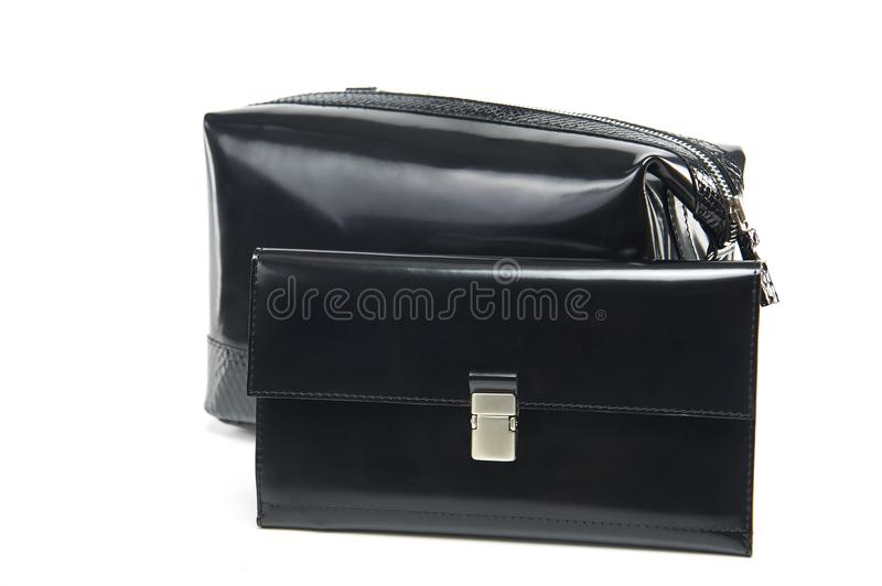 Glancy cosmetic bag and a wallet with a metallic zipper stock photos