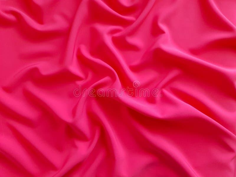 Glansowana tekstura, płaski koralowy tło, tkanina wzór Żywa i bogata koralowa tkanina, ciężka tkanina na białym tle, tapeta zdjęcie royalty free