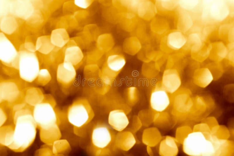 Glanst de goud vage bokeh achtergrond, heldere vakantie, geel, gol stock foto