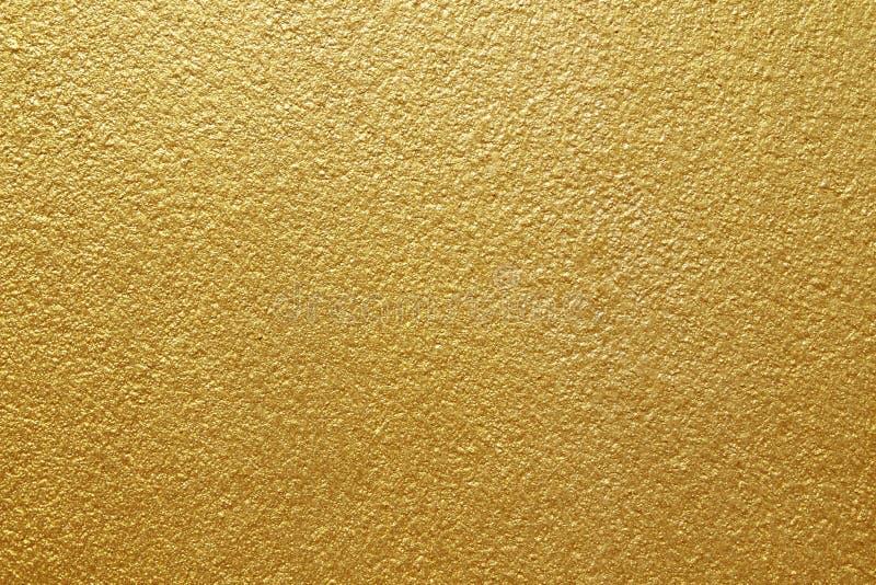 Glanzend geel bladgoud van de achtergrond van de muurtextuur stock afbeelding