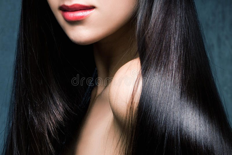 Glanzend zwart haar royalty-vrije stock afbeeldingen