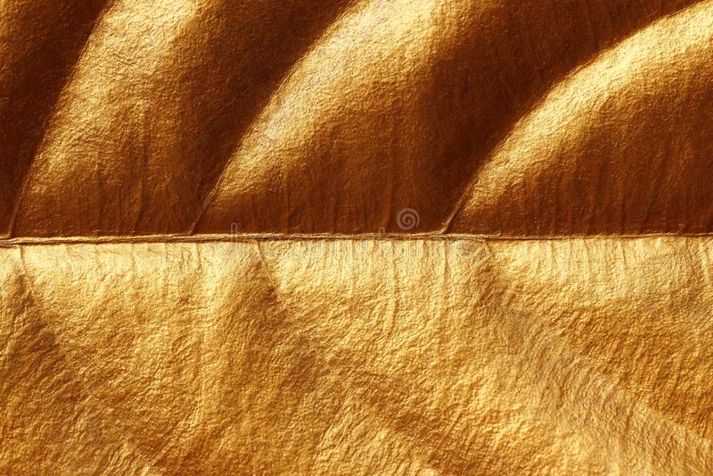Glanzende gele blad gouden textuur voor achtergrond stock afbeelding