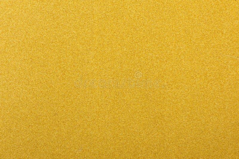Glanzende gele de textuurachtergrond van de blad gouden folie stock fotografie