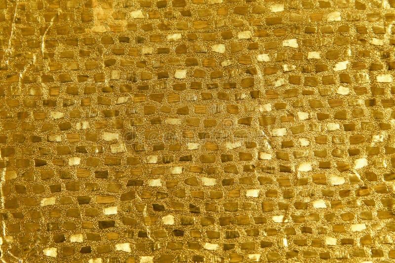 Glanzende gele de textuurachtergrond van de blad gouden folie royalty-vrije stock foto