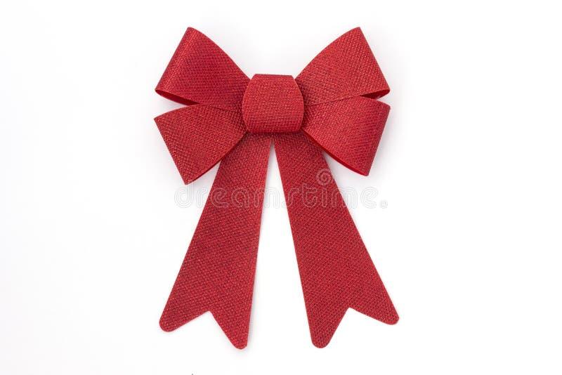 Glanzende rode vakantieboog op wit stock foto