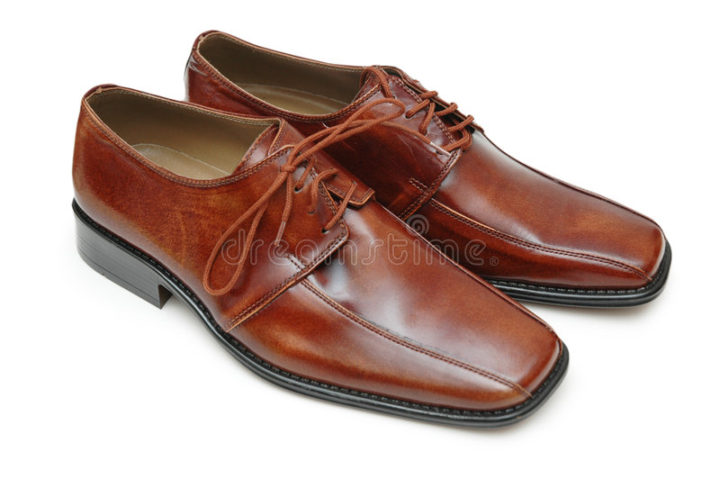 Glanzende schoenen die op wh worden geïsoleerd_ royalty-vrije stock foto