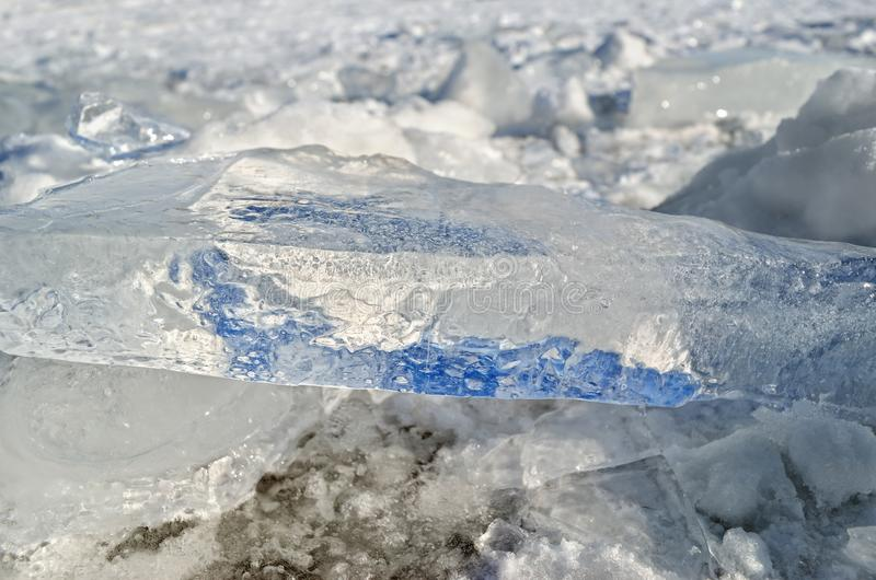 Glare of light reflected in the shards of pure ice.  royalty free stock photography