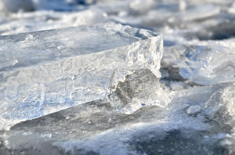 Glare of light reflected in the shards of pure ice.  royalty free stock images