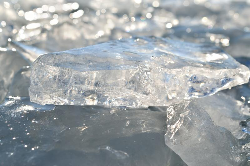 Glare of light reflected in the shards of pure ice.  stock photos