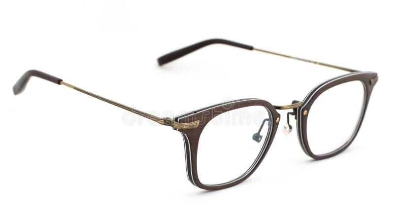 Glasögon för sikt av brun färg på en vit bakgrund fotografering för bildbyråer