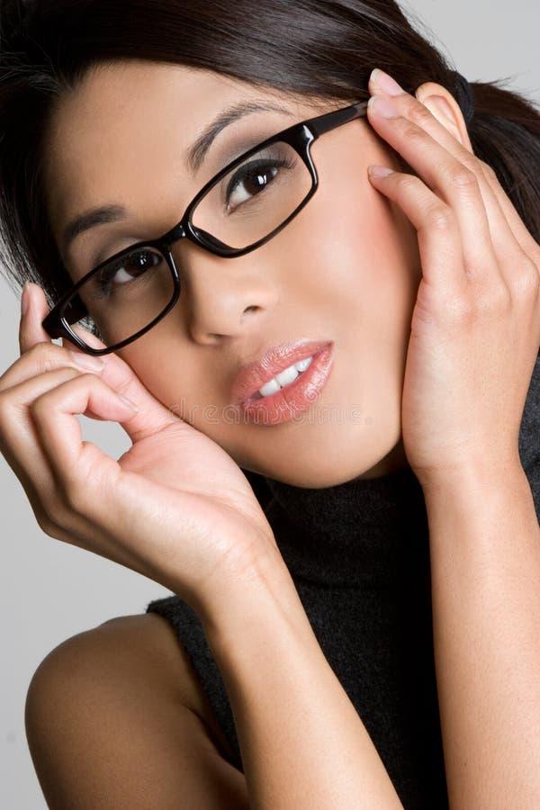 glasögonflickaslitage arkivfoto