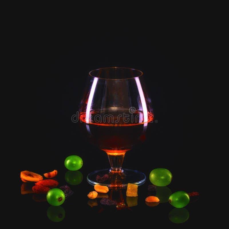Glas cognac stock foto's
