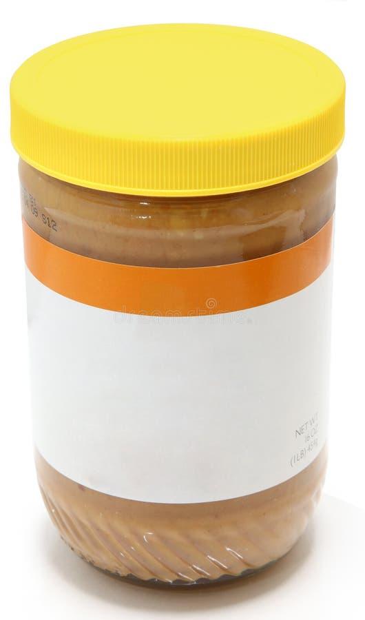 Glas Crunchy Erdnussbutter lizenzfreies stockbild