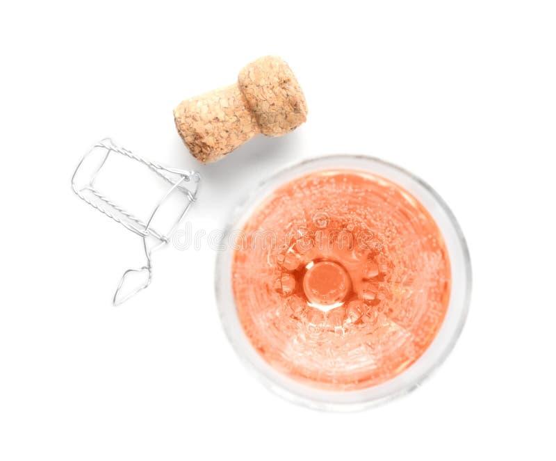 Glas des rosafarbenen Champagners und des Korkensteckers lizenzfreie stockbilder