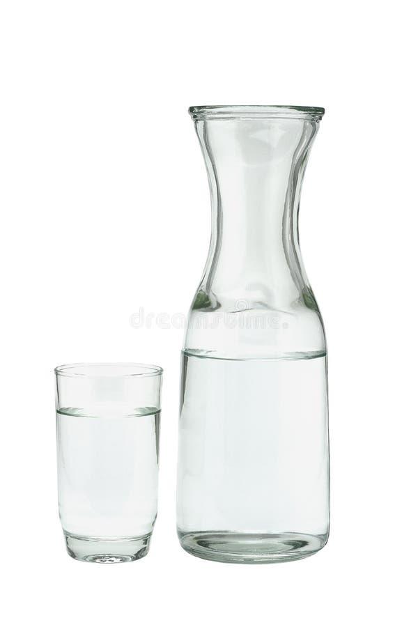 Glas des Wassers und des Kruges stockfotografie