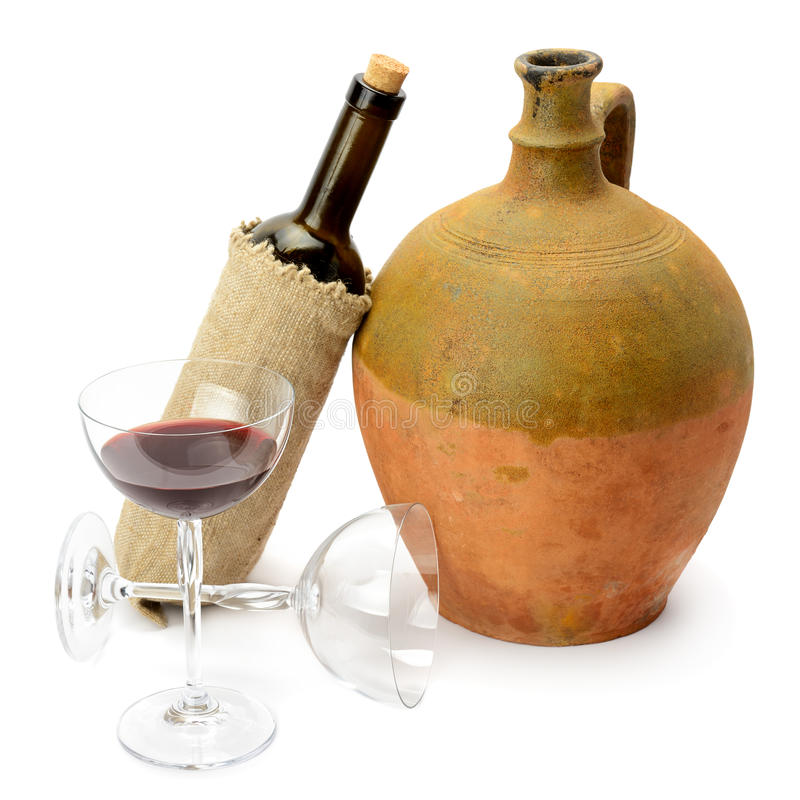 Glas des Weins, der Flasche und der Amphore lizenzfreie stockfotografie