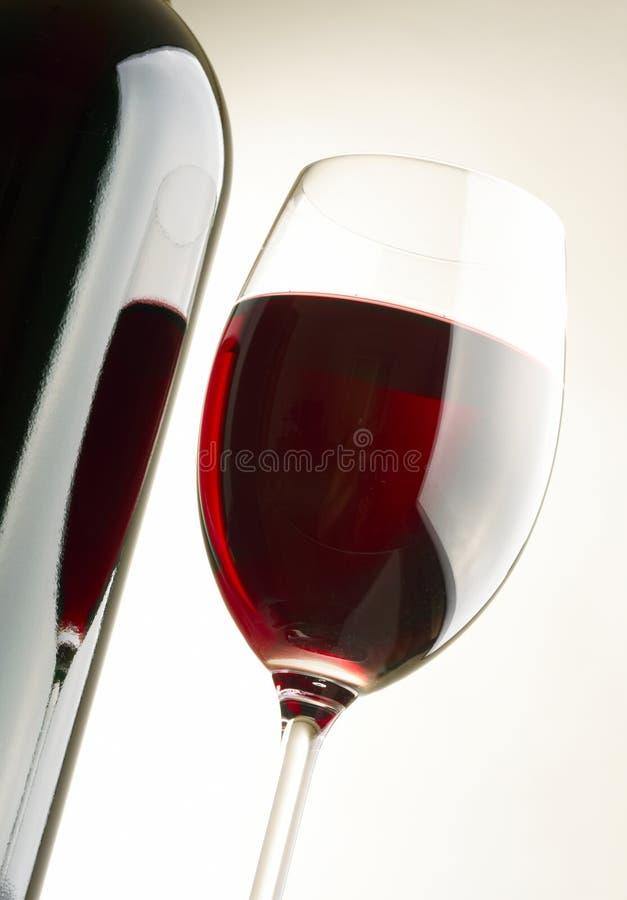 Glas en fles stock fotografie