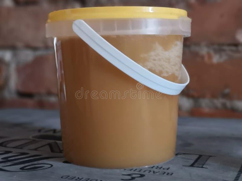 Glas Honig lizenzfreie stockfotos