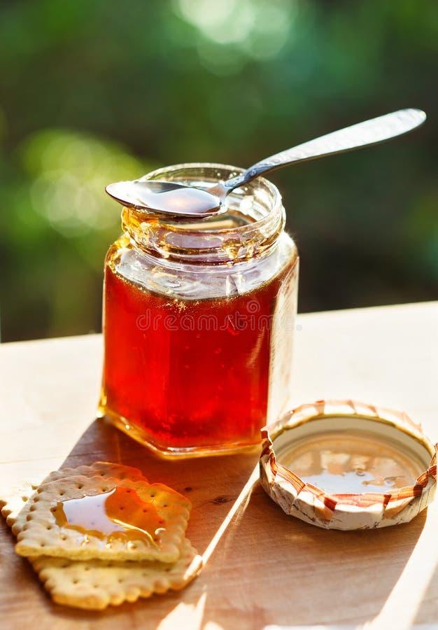 Glas Honig lizenzfreie stockfotografie